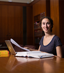 Graduate student working in the library